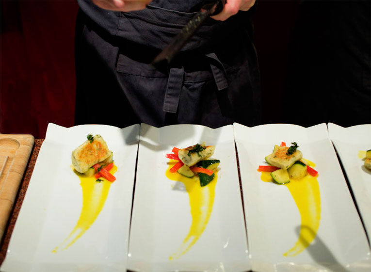 chef-plating-fish-hidden-kitchen